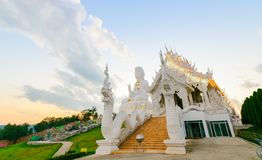 Double Dragon and Guan Yin Statue at Wat Huay Pla Kang. On sunset time, Chinese temple in Chiang Rai Province, Thailand Royalty Free Stock Photography