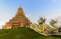 Double Dragon and Pagoda at Wat Huay Pla Kang. On sunset time, Chinese temple in Chiang Rai Province, Thailand Stock Photography