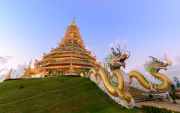 Double Dragon and Pagoda at Wat Huay Pla Kang. On sunset time, Chinese temple in Chiang Rai Province, Thailand Royalty Free Stock Photo
