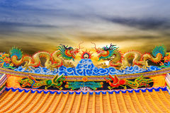 Double Dragon Statue. Sunset Royalty Free Stock Image