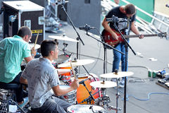 Double drummers and guitar player of Perro (band) in concert at Dcode Festival Stock Photography
