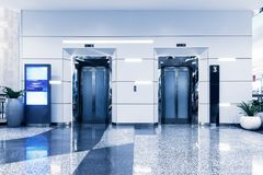 Double elevators in department store, Modern building Royalty Free Stock Images