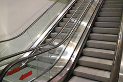 Double escalator staircase of a shopping mall, leading up and down from the basement. Background Stock Images