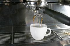Double Espresso. Drawing a double into an espresso, americano, or cappuccino cup Stock Image