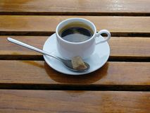 Double espresso coffee in white cup on wooden table Stock Image