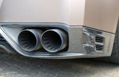 Double exhaust pipe. Part of sports car Stock Image