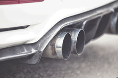 Double exhaust pipes of a modern sports car Stock Photography