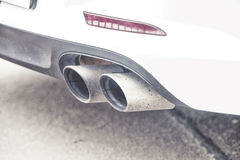 Double exhaust pipes of a modern sports car, Royalty Free Stock Photo