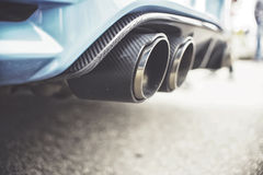 Double exhaust pipes of a modern sports car Royalty Free Stock Photography