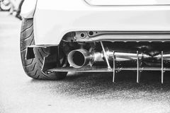 Double exhaust pipes of a modern sports car, black and white Stock Image