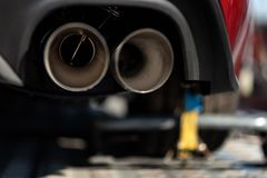 Double exhaust pipes with silence valve of sports car stock photography