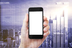 Double explosure with man hand with blank smartphone and city wi Royalty Free Stock Photo