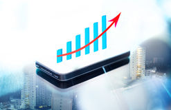 Double expose of business graph on smart phone. Screen Stock Photography