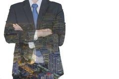 Double exposition d'homme d'affaires et de ville Photographie stock libre de droits