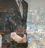 Double exposition d'homme d'affaires touchant un écran imaginaire Images libres de droits