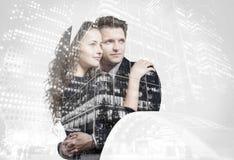 Double exposition de beaux jeunes couples images libres de droits