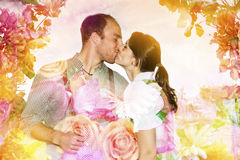 Double exposre of bavarian couple kissing and flowers Royalty Free Stock Photo