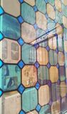 Stained-glass window.double exposure. abstraction. Modern building glass panel facade double exposure. Abstract windows background Royalty Free Stock Image