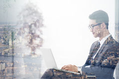Double exposure of Asian businessman using the tablet Royalty Free Stock Photography