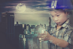 Double exposure of asian child with helmet combined with skyscra Stock Images