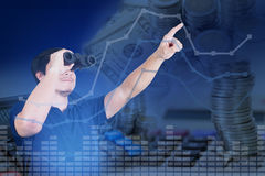Double exposure of Asian investor with binoculars with growth gr royalty free stock photography