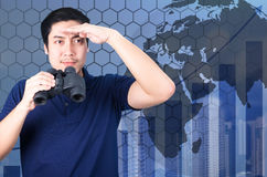 Double exposure of Asian investor with binoculars. Over abstract stock images