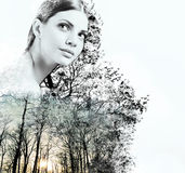 Double exposure of attractive woman and beauty of nature at the Royalty Free Stock Images