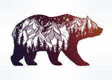 Double exposure bear with mountains landscape. Stock Photos