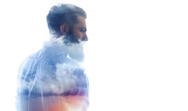 Double exposure of bearded guy and cloudy sky Stock Photography