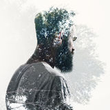 Double exposure of bearded guy and forest Royalty Free Stock Photos