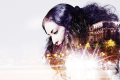 Double exposure of beautiful girl and  city lights Royalty Free Stock Photography