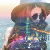 Double exposure,Beautiful girl and cityscape. Royalty Free Stock Image