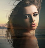 Double exposure of beautiful makeup woman mixed with sunset natu Royalty Free Stock Photography