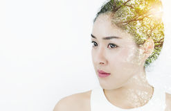 Double exposure, Beautiful young attractive Asian woman with tree and bright sunlight, on white background Royalty Free Stock Photography