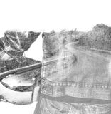 Double exposure of a biker and a winding road Royalty Free Stock Image