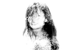 Double exposure black and white bw portrait of young woman cover. Ing her eyes with hair combined with photograph of nature Royalty Free Stock Photography