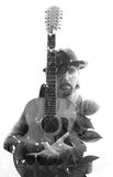 Double exposure in black and white of a performer   Stock Photography