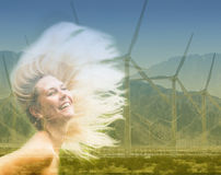 Double exposure of blond woman and wind turbine Stock Photos