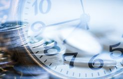 Double exposure blurry coin with clock background investment and royalty free stock photography