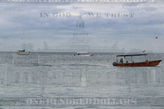 Double exposure boats on ocean water with hundred dollar background Stock Photography