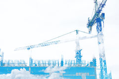 Double exposure, Building construction site with blue sky and white cloud, on white background with copy space Royalty Free Stock Photos