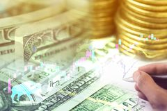 Bullish market of the stock world with US dollars banknote and c. Double exposure of bullish market of the stock world with US dollars banknote and coins stock photos
