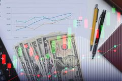 Double exposure of business Calculator and pen and Dollar money. With stock market or financial graph for financial investment and trading concept Stock Photos