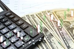 Double exposure of business Calculator and pen and Dollar money. With stock market or financial graph for financial investment and trading concept Royalty Free Stock Image