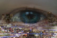 Double exposure of business concept, business eye man look trough the cityscape or landscape in the city with bokeh light stock images