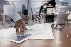 Double exposure of business documents on office table Royalty Free Stock Photos