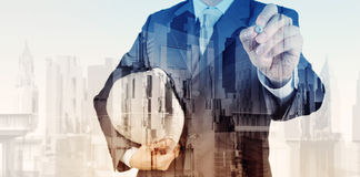 Double exposure of business engineer and abstract city Royalty Free Stock Images