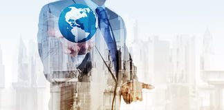 Double exposure of business engineer holding the earth Royalty Free Stock Photos
