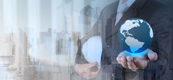 Double exposure of business engineer holding the earth Stock Images