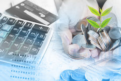 Double exposure business growth , financial concept hand holding coin calculator royalty free stock photos